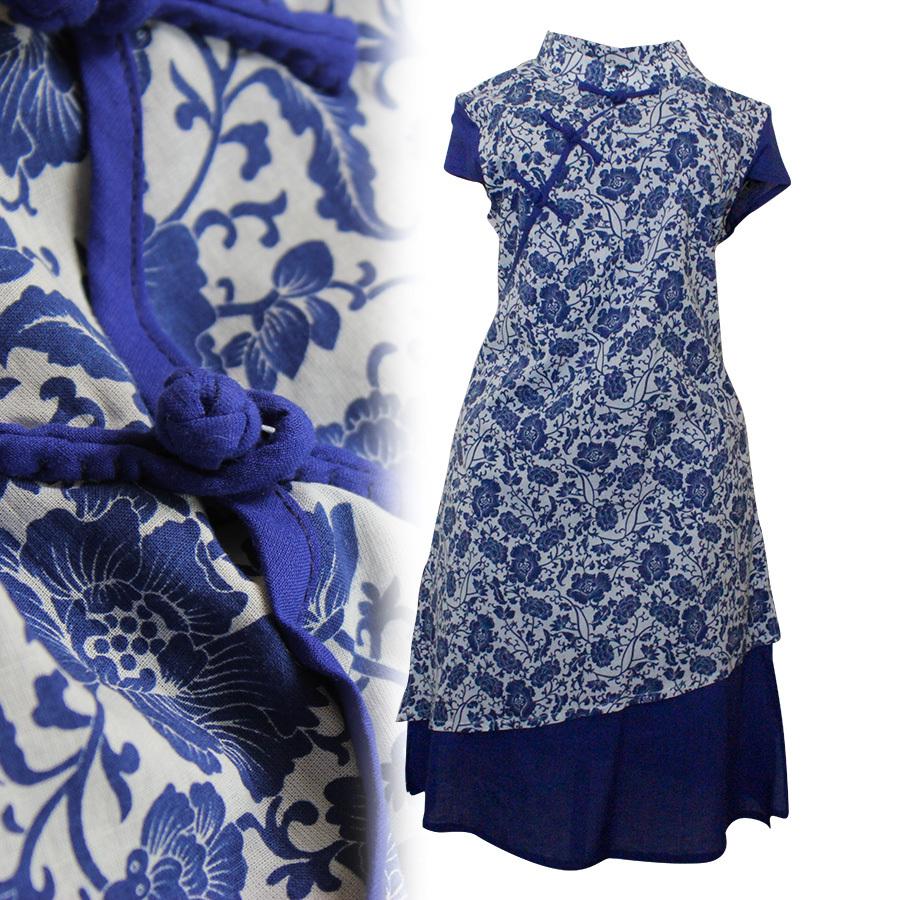 小立领,蓝色袖口,斜下摆设计