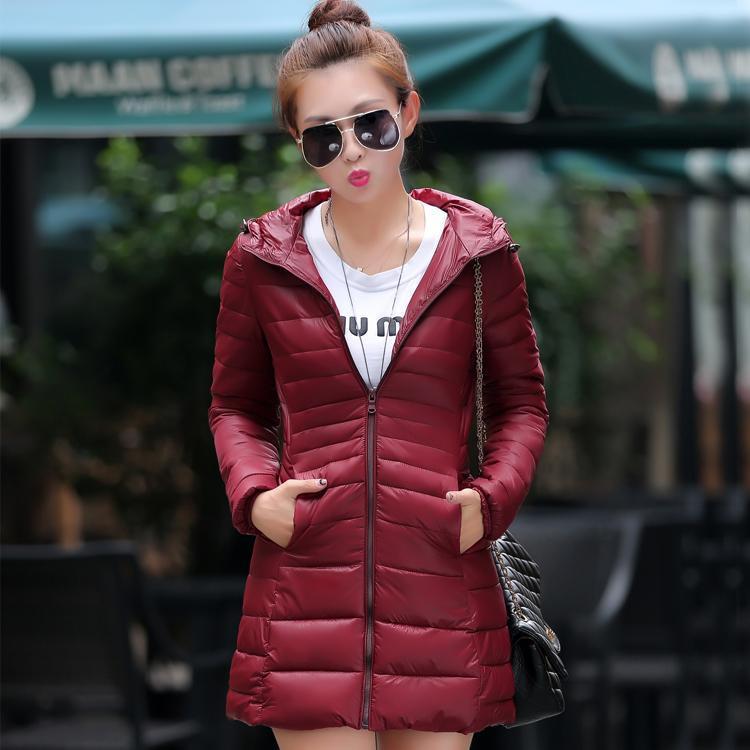 2015秋冬新款韩版女外套修身轻薄活帽女装中长款羽绒服女童时尚立领高跟鞋鱼嘴图片