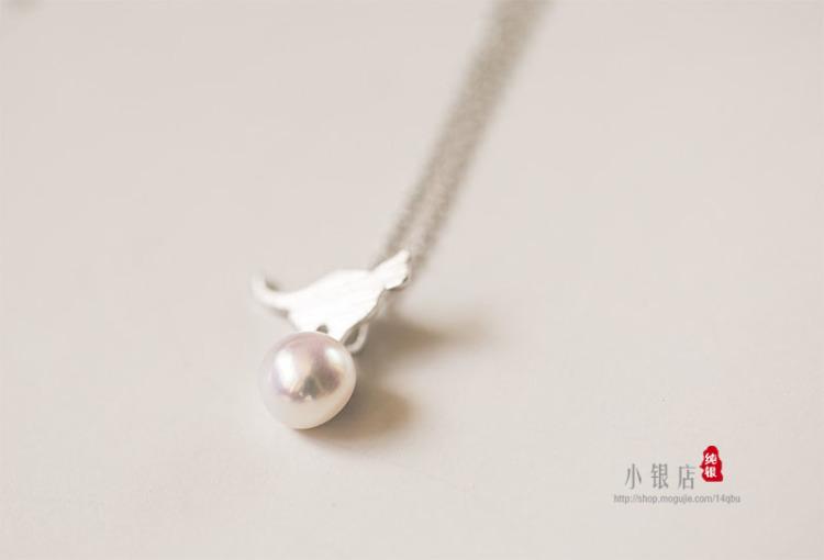 珍珠镶嵌动物吊坠