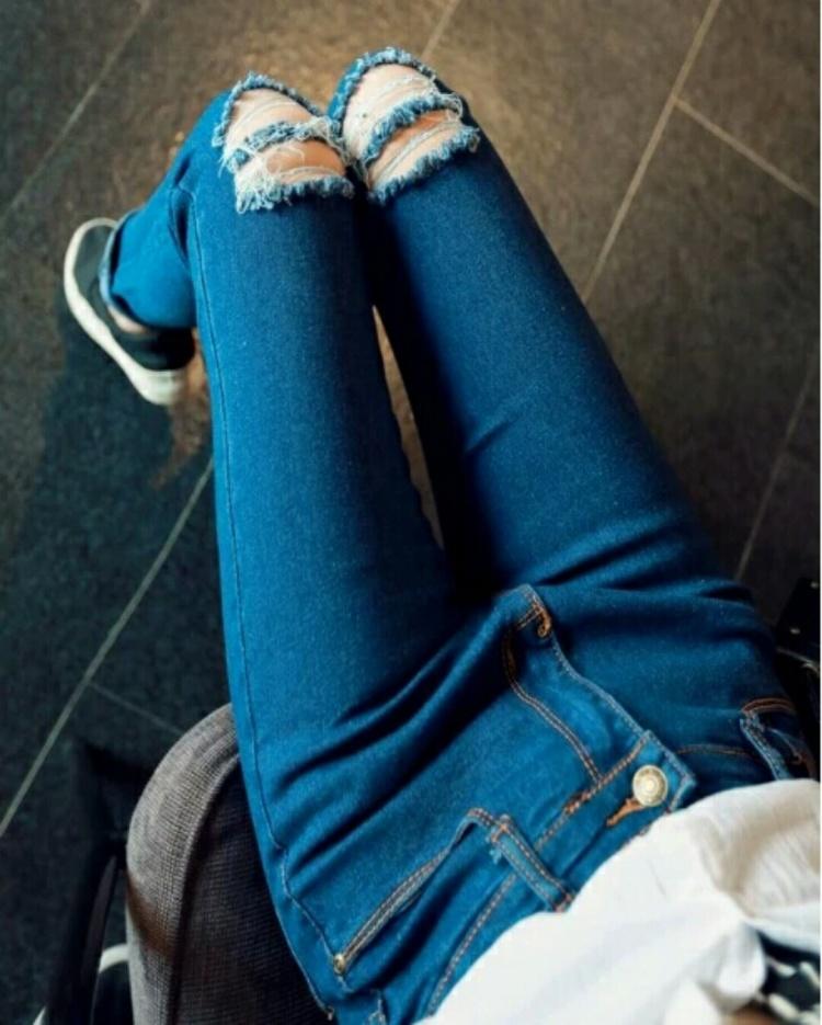 瘦包腿低腰做旧破洞牛仔裤